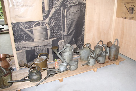 Watering cans in the Gardening Museum - Gaissmayer Nursery