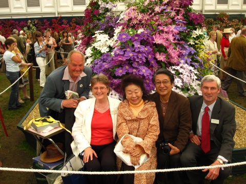 Left to right Charles Welch, Ruth Gooch, Kuniko Atarashi, Kinju Atarashi and Jon Gooch at Chelsea Flower Show 2010 with Clematis 'Kinju Atarashi' immediately behind Kuniko Atarashi©Tolver Gooch Ltd.